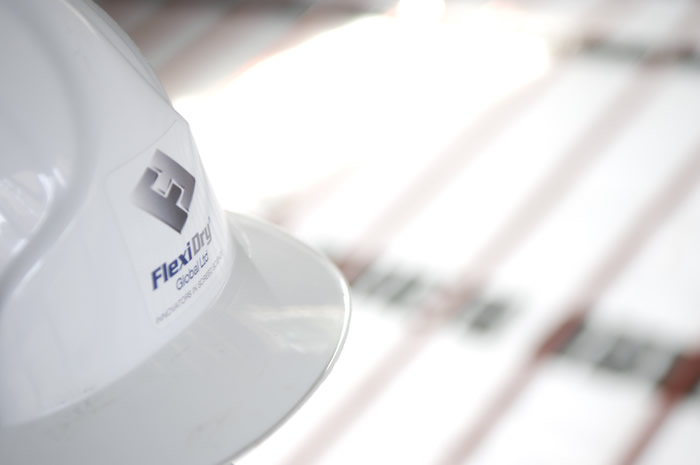Flexidry logo seen in an image with helmet and underfloor heating